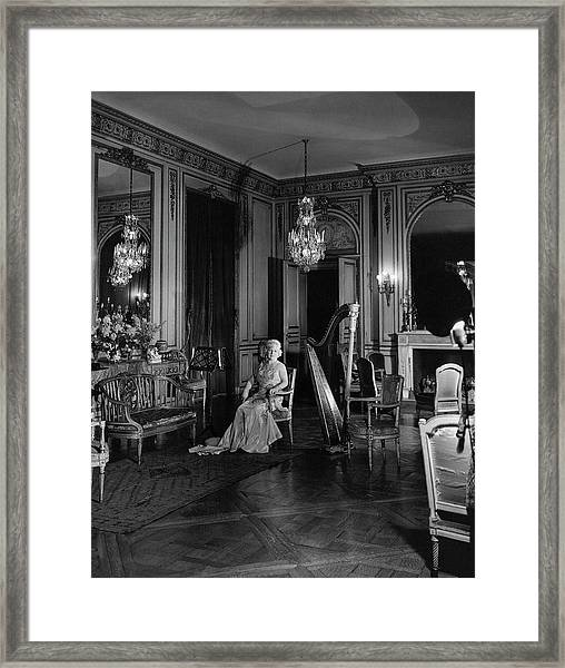 Mrs. Cornelius Sitting In A Lavish Music Room Framed Print