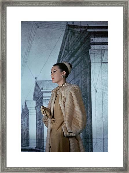 Mrs. Hugh Chisholm Wearing A Fur Coat Framed Print by John Rawlings