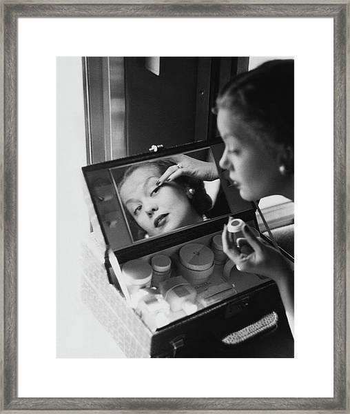 Mrs. Thomas Phipps Applying Make-up Framed Print by Constantin Joffe