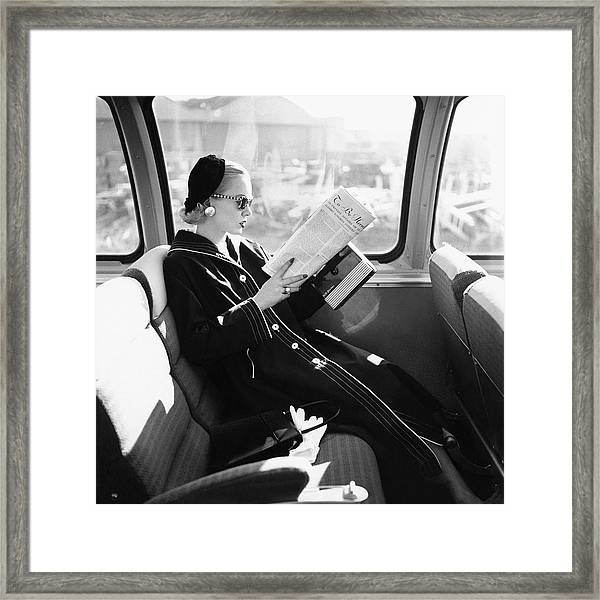 Mrs. William Mcmanus Reading On A Train Framed Print