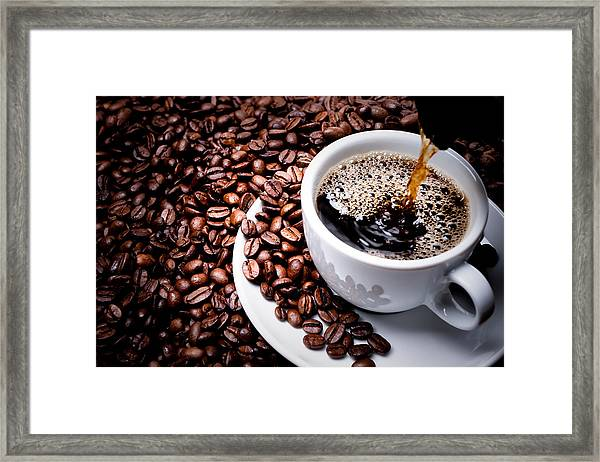 Mug On Plate Filled With Coffee Surrounded By Coffee Beans  Framed Print by GeorgHanf