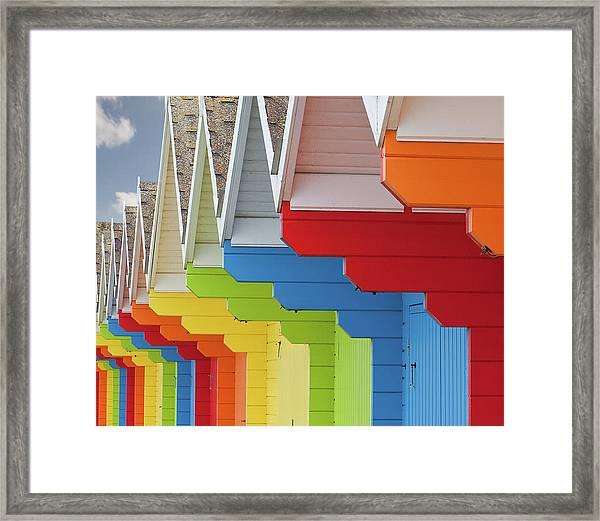 Multi Coloured Beach Huts Framed Print