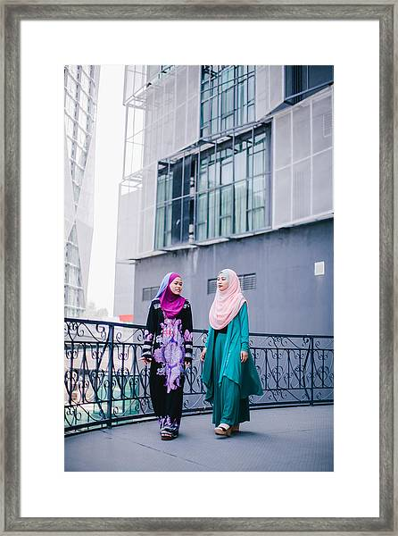 Muslim Women In Hijab In Discussion Framed Print by Mikhaella Ismail