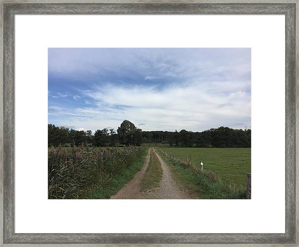 Narrow Dirt Road Along Trees Framed Print by Paulien Tabak / EyeEm
