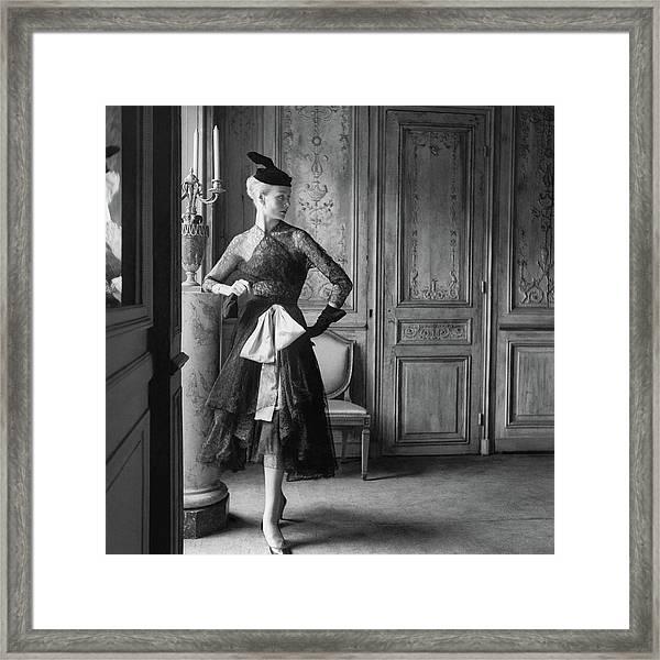 Nina De Voogd Wearing A Dress And Hat Framed Print