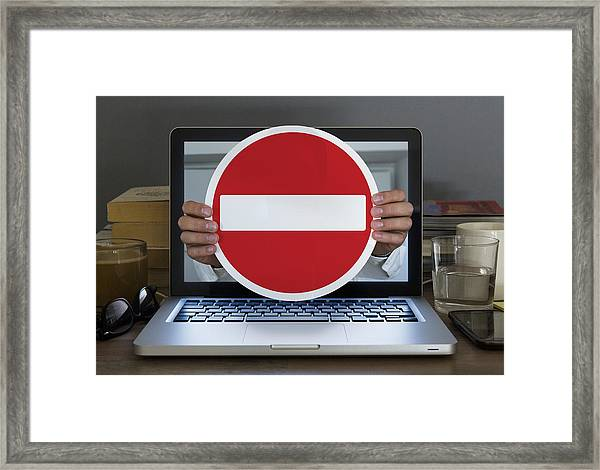 No Entry Sign Appearing Out Of Laptop Computer Framed Print by Dimitri Otis