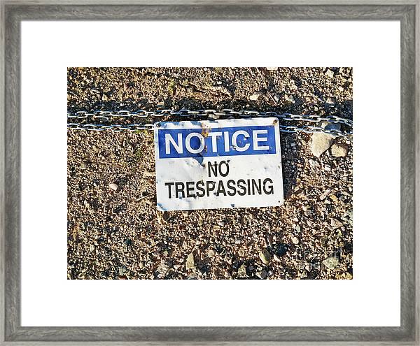 No Trespassing Sign On Ground Framed Print