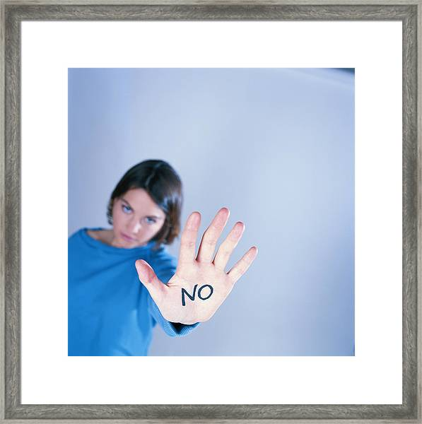 no Written On Palm Of Young Woman (focus On Palm) Framed Print by David De Lossy
