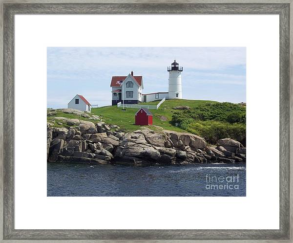Nubble Lighthouse In Maine Framed Print