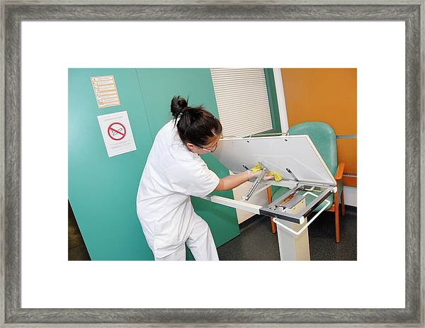 Nurse Cleaning Hospital Table Framed Print by Aj Photo/science Photo Library