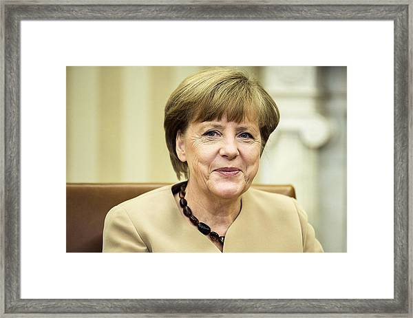 Obama And German Chancellor Merkel Hold Joint Press Conference At White House Framed Print by Pool