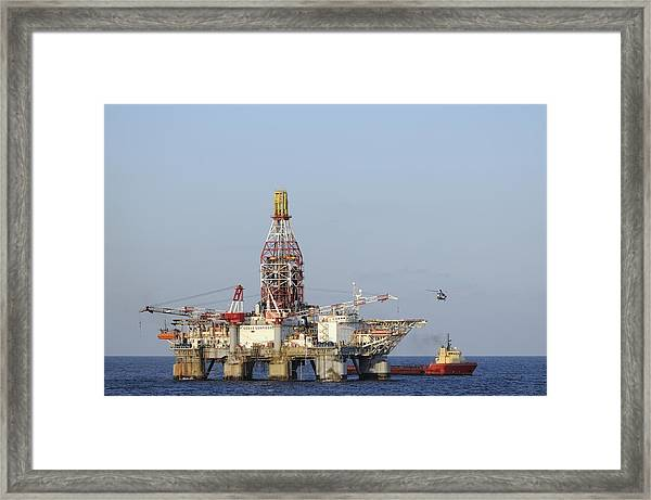 Off Shore Oil Rig With Helicopter And Boat Framed Print