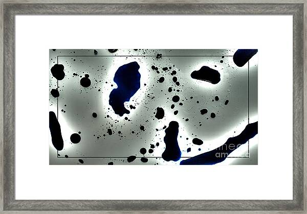 Oil Leak Framed Print