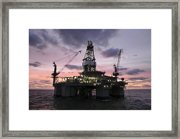 Oil Rig At Dawn Framed Print