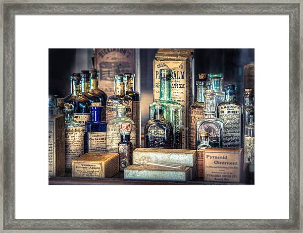 Ointments Tonics And Potions - A 19th Century Apothecary Framed Print