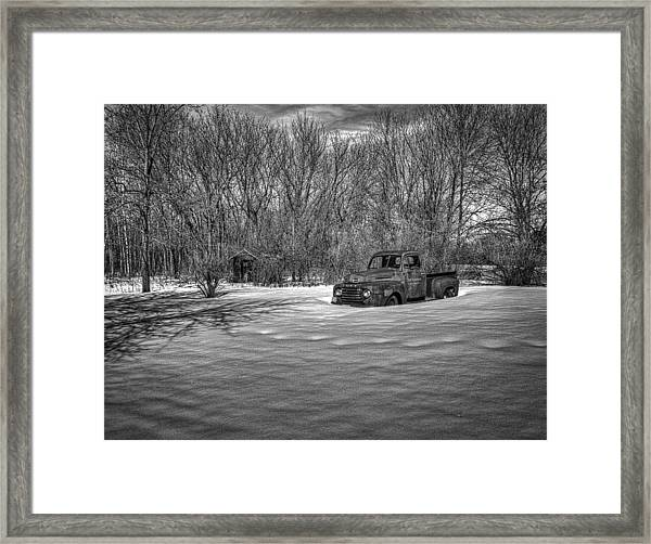 Old Timer In The Snow Framed Print