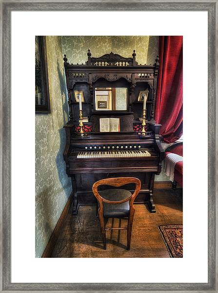 Olde Piano Framed Print