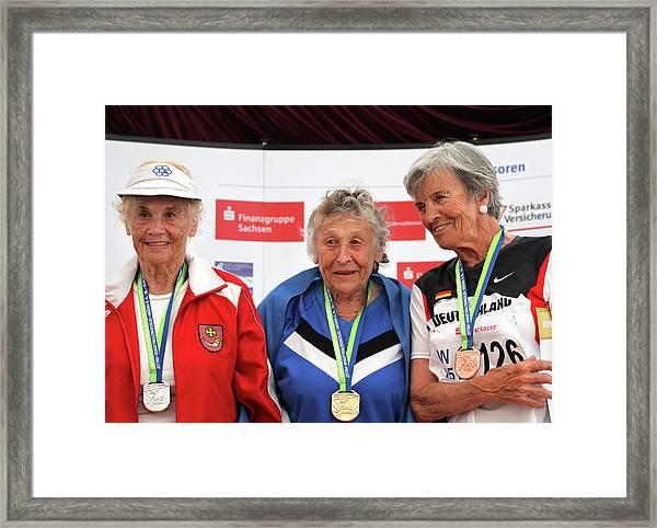 Older Female Athletes On Medals Rostrum Framed Print by Alex Rotas
