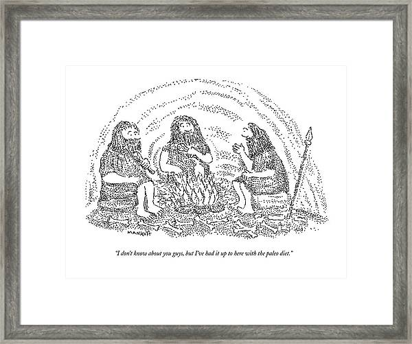 One Caveman Talks To Another Who Is Eating Framed Print
