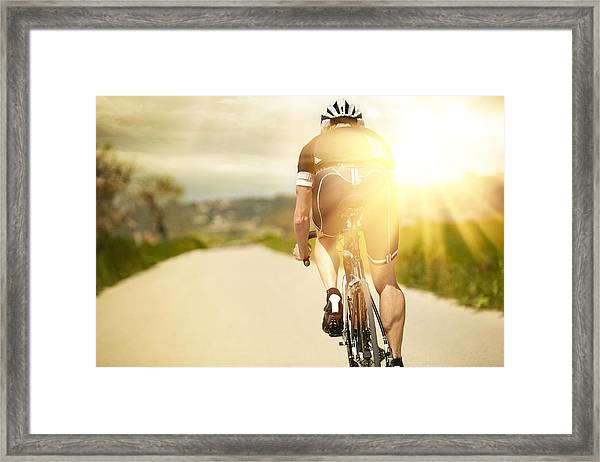 One Man And His Bicycle Framed Print by Sohl
