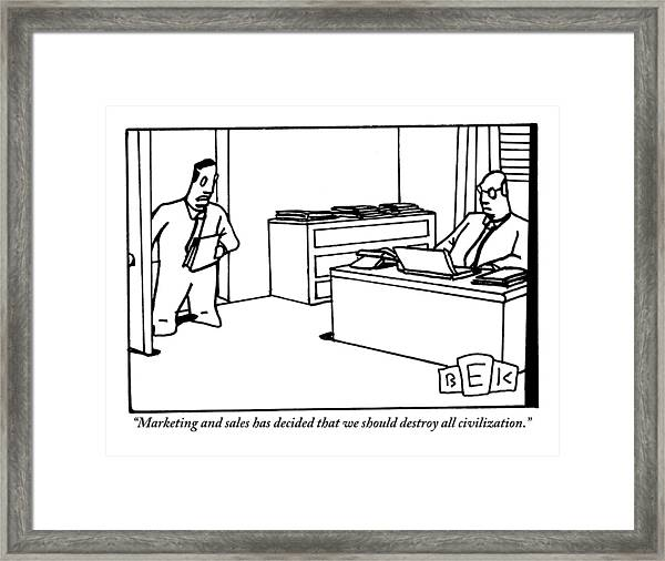 One Office Worker Speaks To Another Seated Framed Print