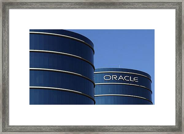 Oracle Makes Hostile Bid For Rival Peoplesoft Framed Print by Justin Sullivan