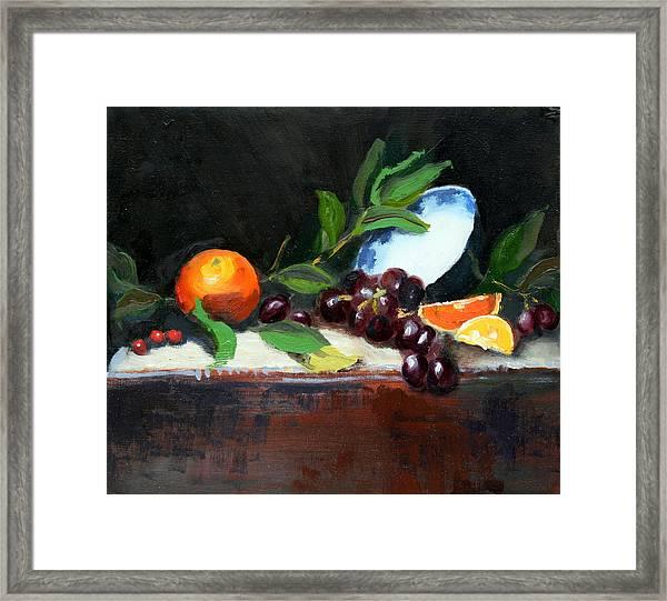 Oranges And Grapes Framed Print
