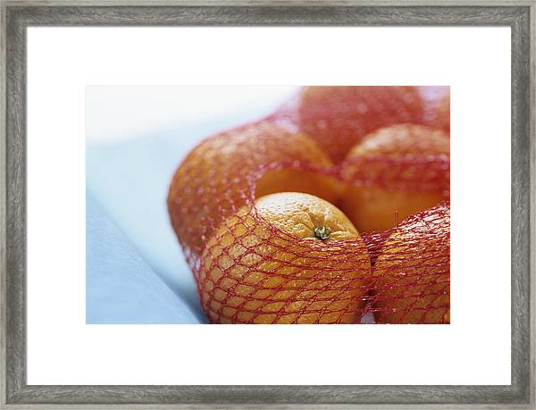 Oranges In Net, Close Up Framed Print by Achim Sass