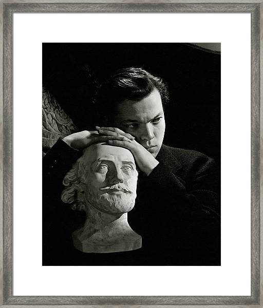 Orson Welles Resting On A Sculpture Framed Print