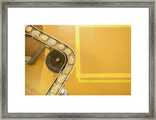 Overhead View Of Freshly Made Biscuits Framed Print by Monty Rakusen