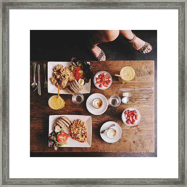 Overhead View Of Woman's Legs And Breakfast Table Framed Print by Justhanni