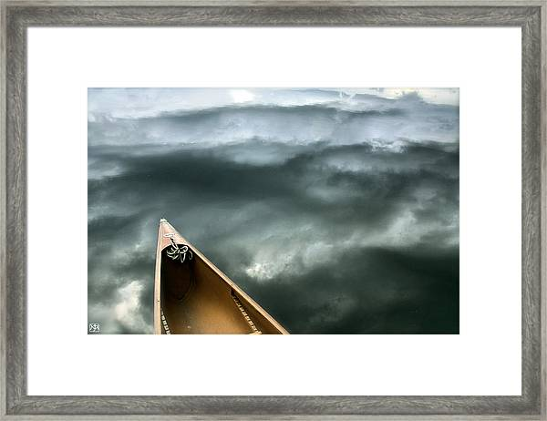 Paddling Before The Storm Framed Print
