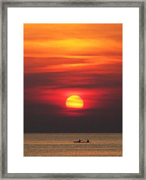 Paddling Under The Sun Framed Print