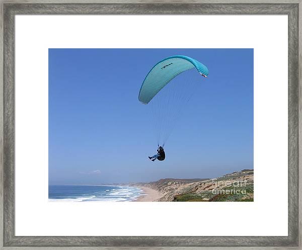 Paraglider Over Sand City Framed Print