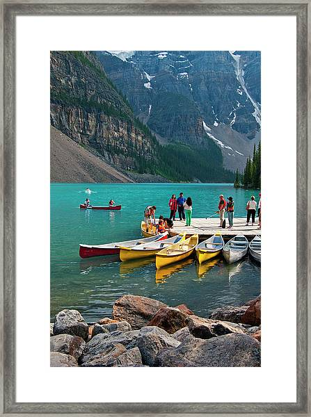 Passengers Renting Colourful Canoes On Framed Print by Emily Riddell
