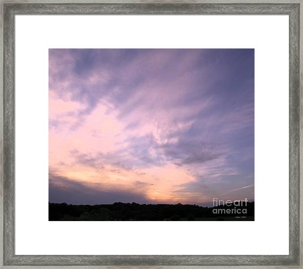Pastel Clouds Framed Print