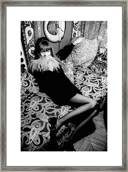 Penelope Tree Sitting On A Paisley Couch Framed Print by Arnaud de Rosnay