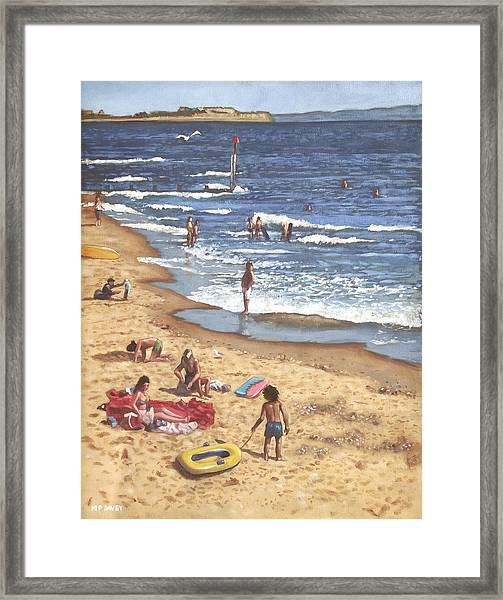 people on Bournemouth beach Blue Sea Framed Print