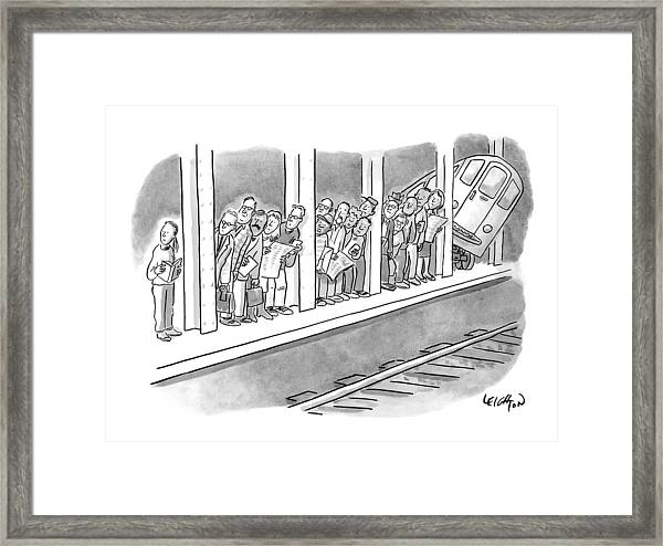 People Waiting For A Subway Peek Onto The Tracks Framed Print