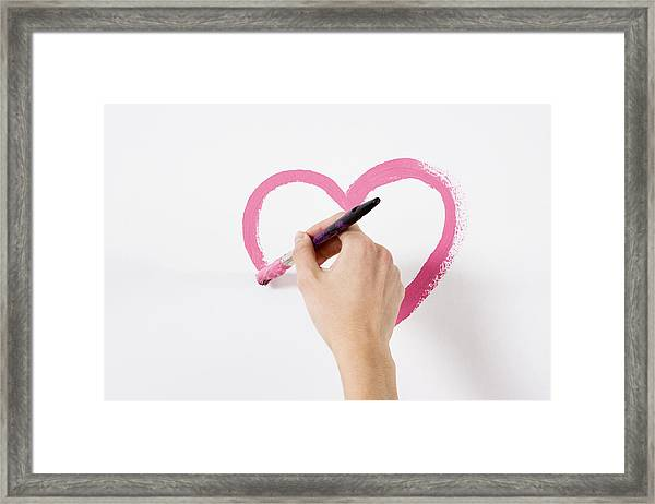 Person Painting A Heart Framed Print by Image Source