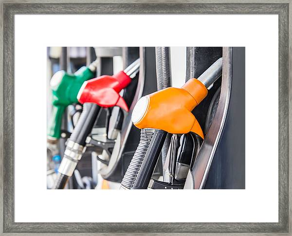 Petrol Pump Filling Framed Print by FeelPic