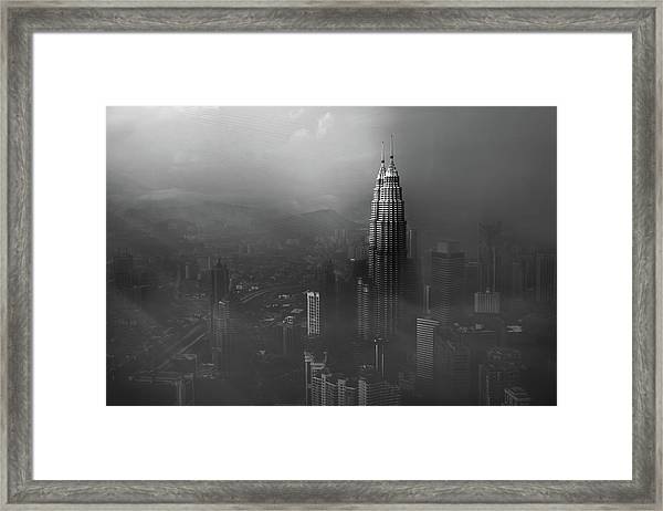 Petronas Towers In A Foggy Afternoon Framed Print