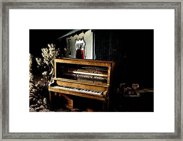 Piano In The Dark.  Framed Print