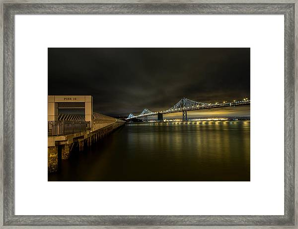 Pier 14 And Bay Bridge At Night Framed Print