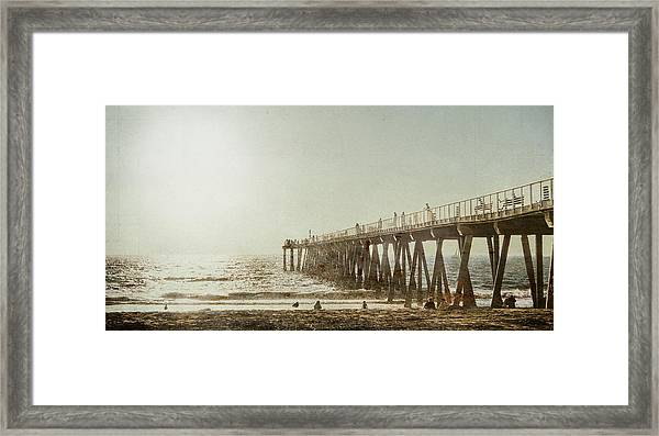 Pier Approaching Sunset Framed Print