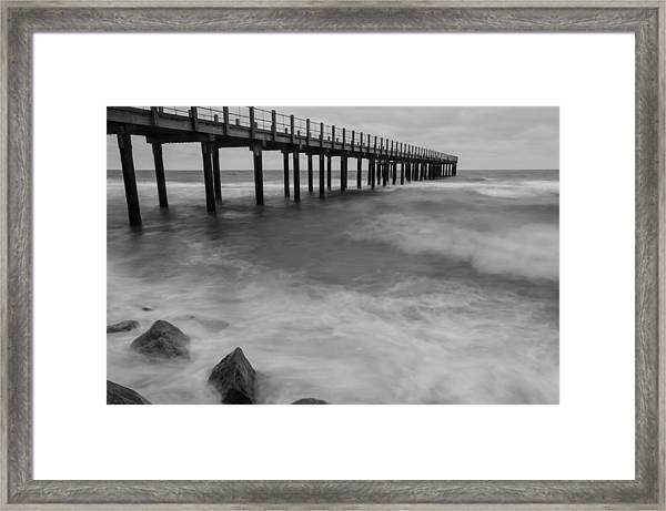 Pier In A Storm Framed Print