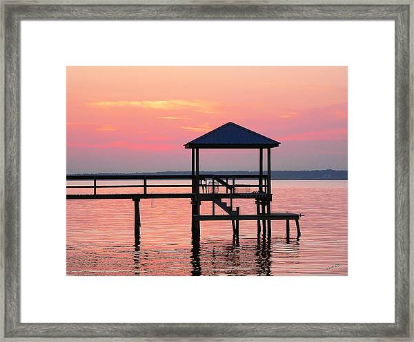 Pier In Pink Sunset Framed Print