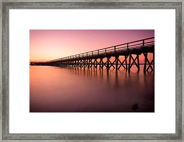 Pier Into The Distance Framed Print