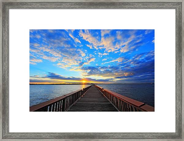 Pier Into The Sunset Framed Print