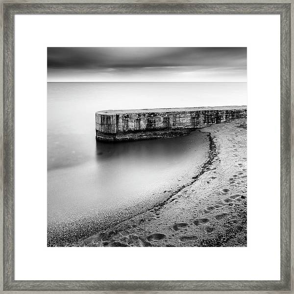 Pier On The Beach Framed Print by George Digalakis
